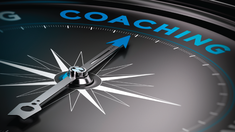 Compass Pointing to the word Coaching